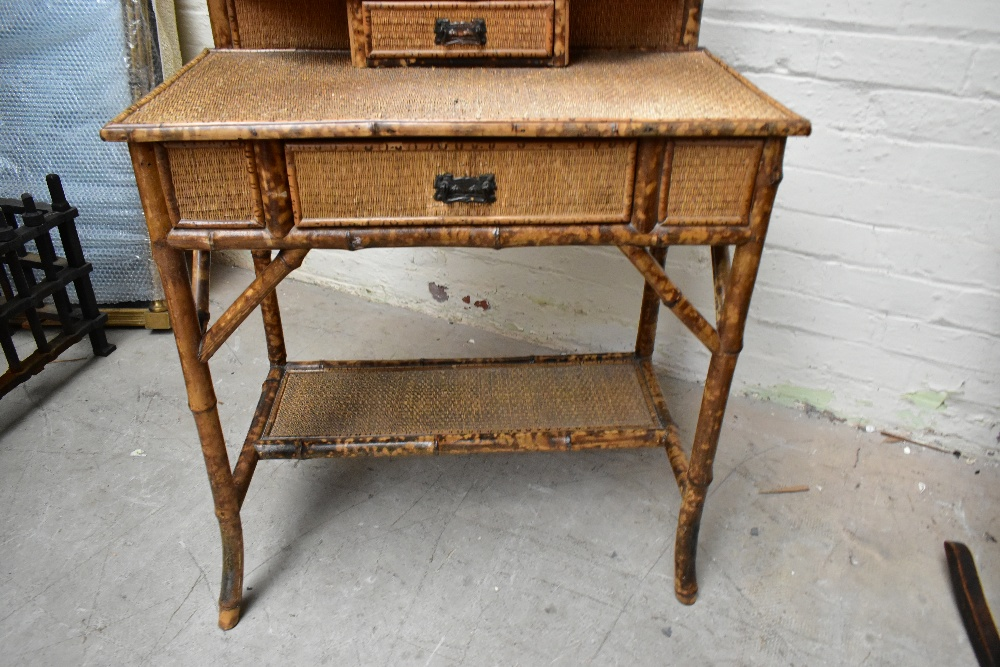 An early 20th century bamboo mirror back dressing table, with two drawers raised on column supports, - Image 2 of 7