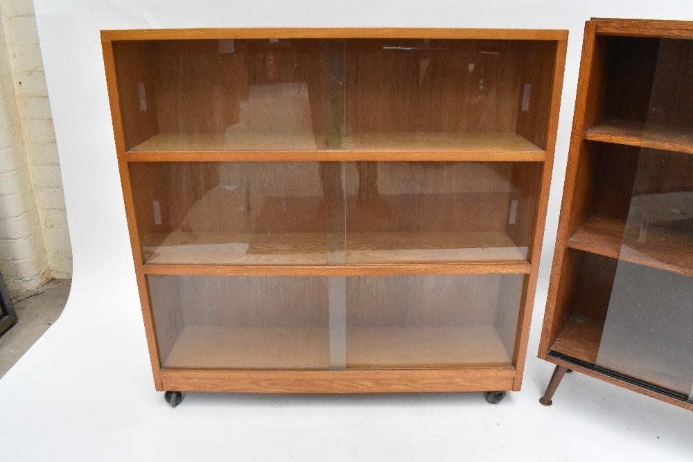 An oak bookcase with three sliding glass doors on castors, height 91cm, width 91.5cm, depth 22cm, - Image 2 of 6