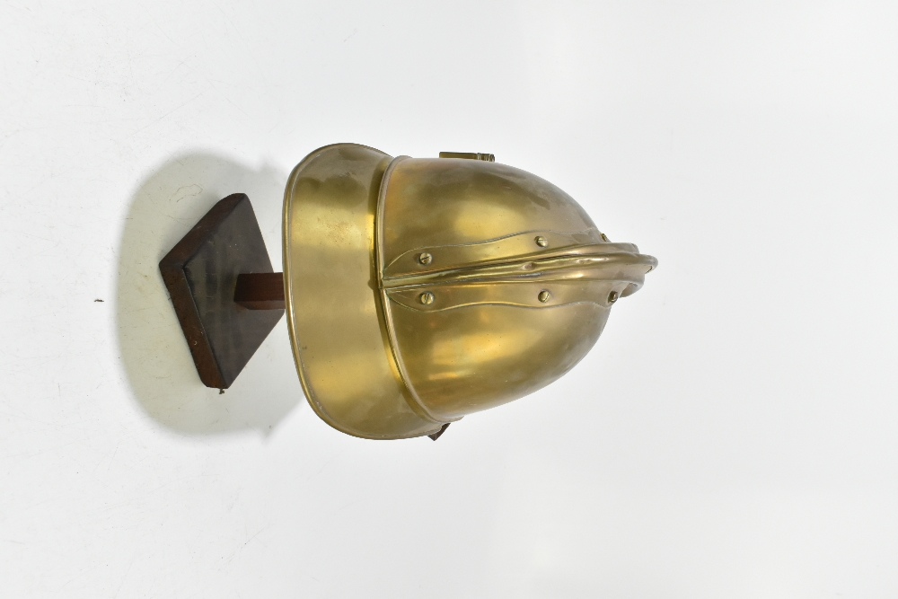 A French fireman's brass helmet with applied badge inscribed 'Sapeurs Pompiers De Neuille Le L.', - Image 3 of 6