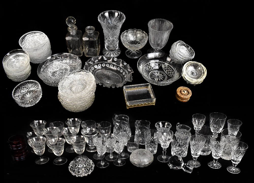 A large quantity of assorted cut and pressed glassware, to include vases, various drinking