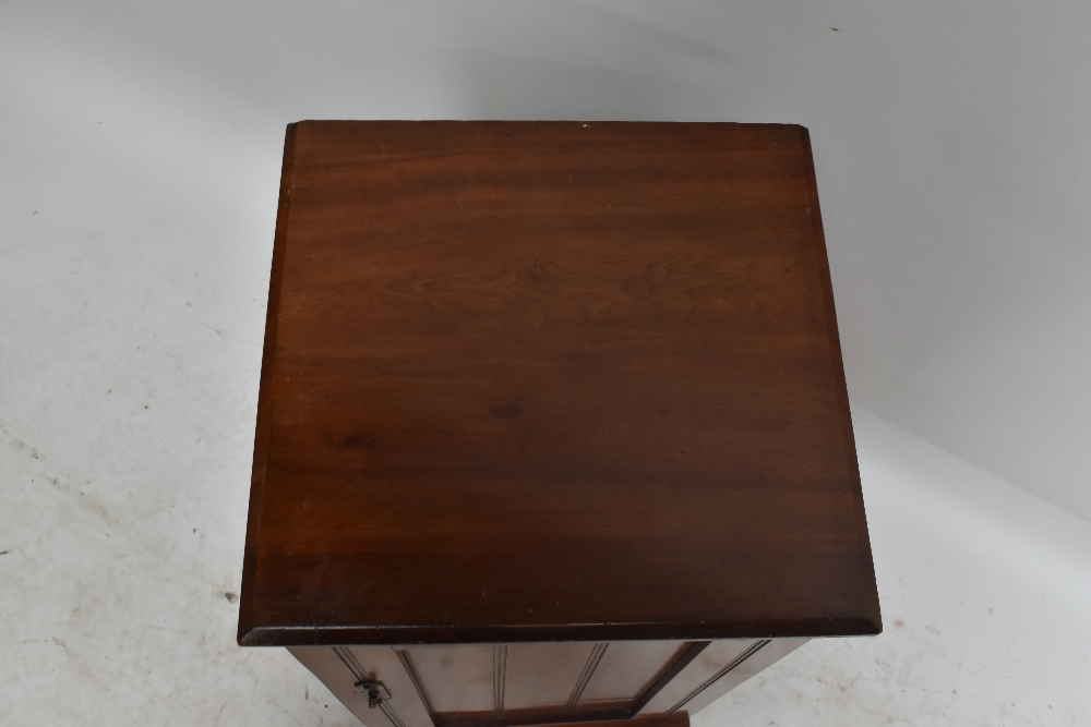 An Edwardian walnut pot cupboard, the single panel door enclosing a fixed shelf, raised on plinth - Image 2 of 3