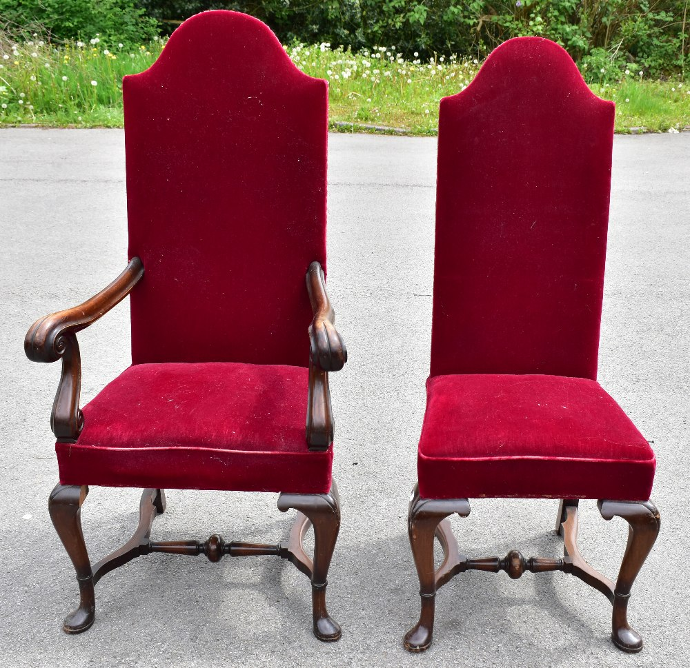 A set of five early 20th century mahogany framed high back dining chairs, upholstered in a red