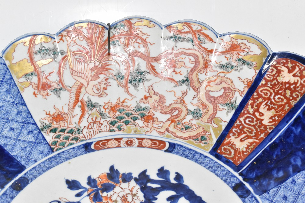 A large late 19th century Japanese Imari charger, of circular form with panelled detail depicting - Image 2 of 5