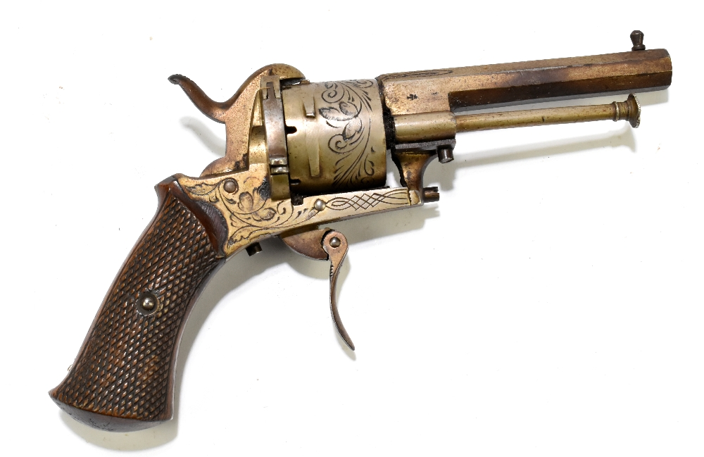 A Belgian pinfire double action revolver with folding trigger, simple engraving and checkered walnut