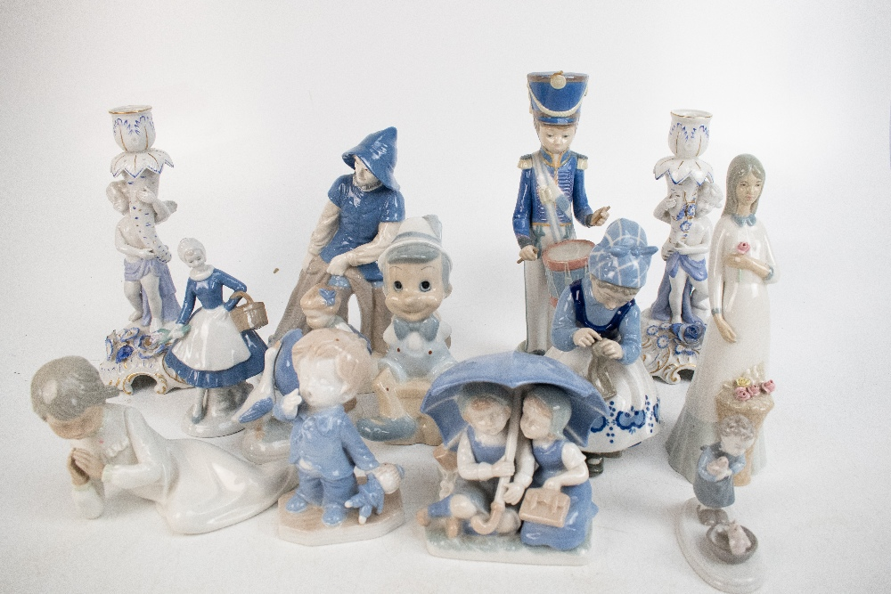 A group of ceramic figures with Lladro examples including drummer boy (af) and a Nao recling girl, - Image 4 of 4