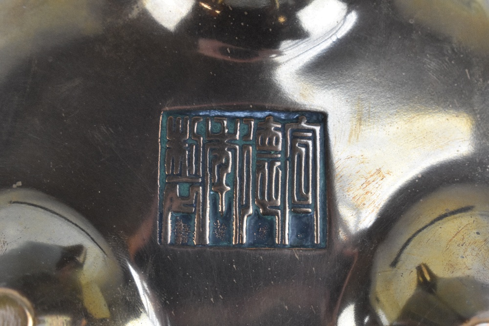 A Chinese bronze censer with raised pierced handles, three simple tapering supports and impressed - Image 7 of 7