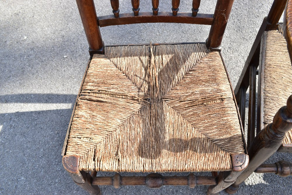 A matched set of six 19th century and later rush seated spindle back chairs, to include an elm - Image 2 of 4
