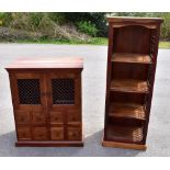 An Indonesian mango wood cupboard with twin doors to upper section above eight short drawers, height