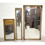 A 19th century gilt wood wall mirror of rectangular form, with boarded back, 141 x 73cm, together