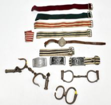 Two late 19th/early 20th century pairs of handcuffs, one pair with military issue broad arrow mark