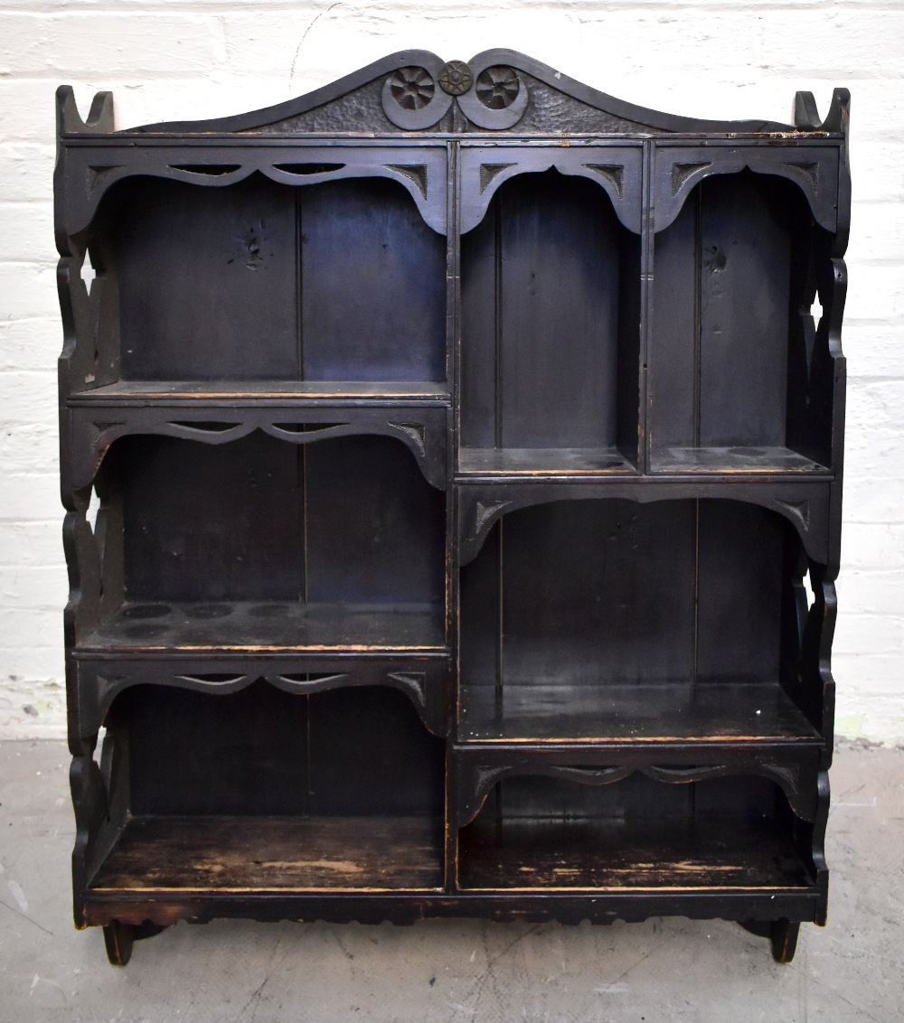 A 19th century carved oak wall cupboard, with an arrangement of seven sections with carved side