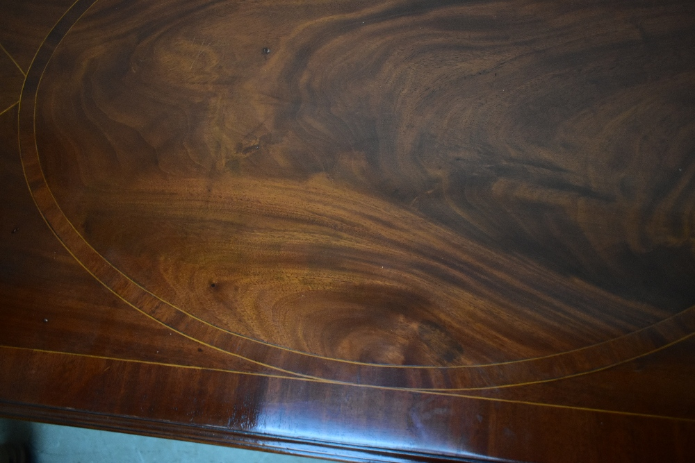A Georgian inlaid mahogany sideboard, the large central drawer above carved arch shaped secret - Image 7 of 7