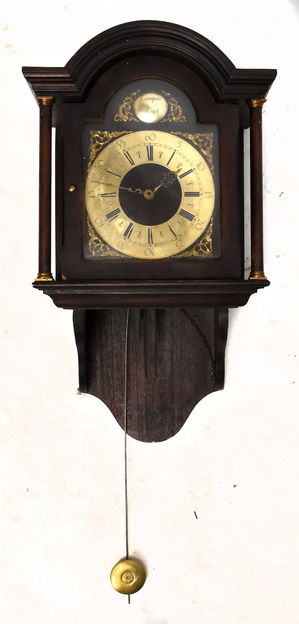 A German mahogany and stained pine eight day wall clock with brass Roman numeral chapter ring and