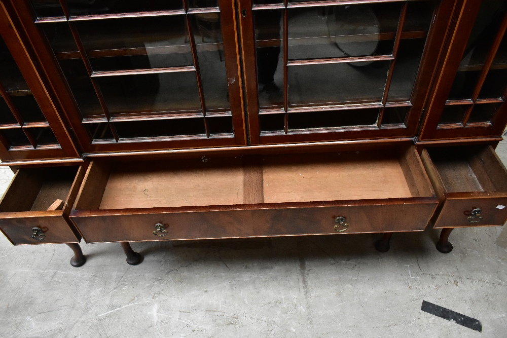An early 20th century inlaid mahogany inverted breakfront display cabinet, the four astragal - Image 7 of 7
