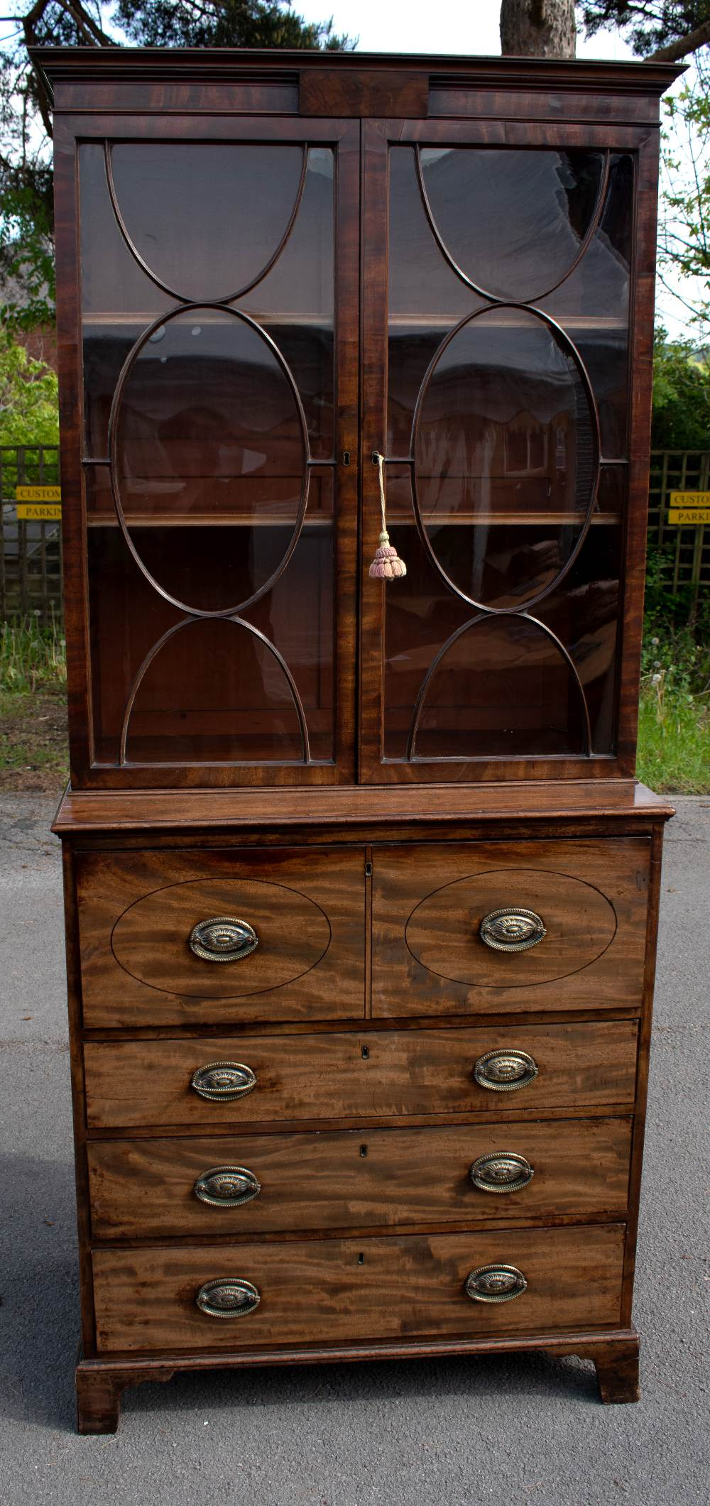 An early 19th century mahogany secretaire bookcase with moulded cornice above two astragal glazed