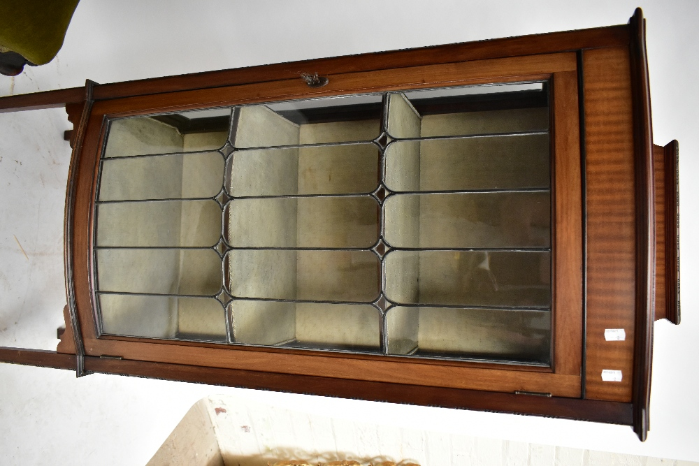 An early 20th century mahogany bow front display cabinet, the leaded glazed door enclosing two - Image 3 of 3