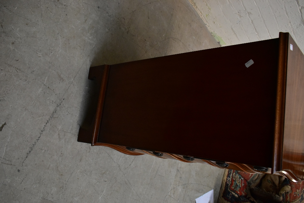 JAYCEE; a reproduction mahogany serpentine chest with moulded top above five graduated drawers, on - Image 5 of 5