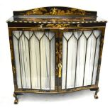 An early 20th century black lacquered serpentine fronted display cabinet with chinoiserie