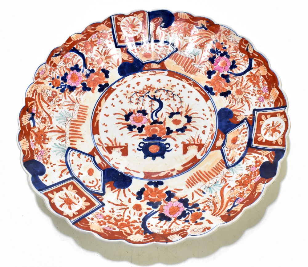An early 20th century Japanese Imari charger with scalloped shaped rim, diameter 47cm.Additional