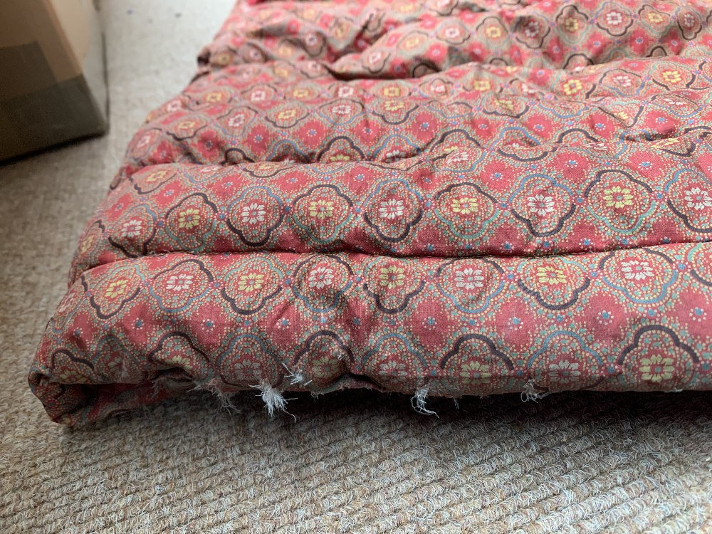Two late Victorian quilted underskirts/winter petticoats, one decorated with a floral design against - Image 5 of 10