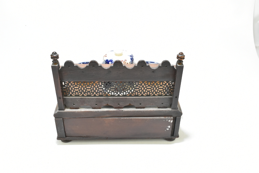 An early 20th century oak smoking stand with pierced pipe rack back above a ceramic lidded jar and - Image 3 of 4