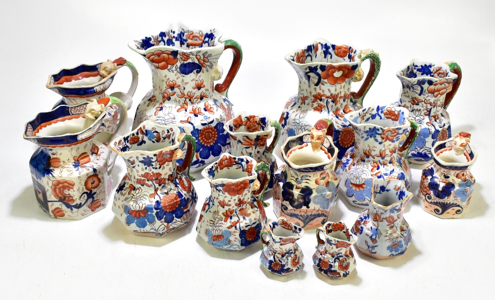 Thirteen assorted 19thcentury and later ironstone jugs, each decorated in the Imari palette, height