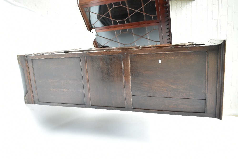An early 20th century oak wardrobe, the pair of linen fold carved doors enclosing rail, raised on - Image 2 of 4