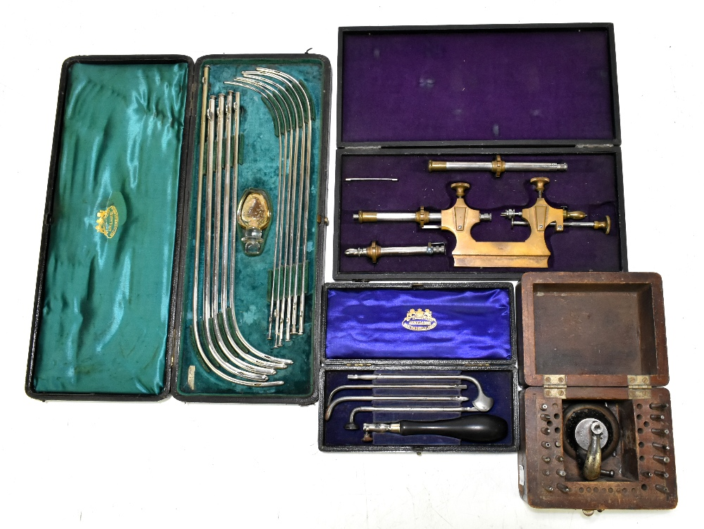 ARNOLD & SONS LONDON; a stainless steel cased catheter set, together with a smaller cased example,