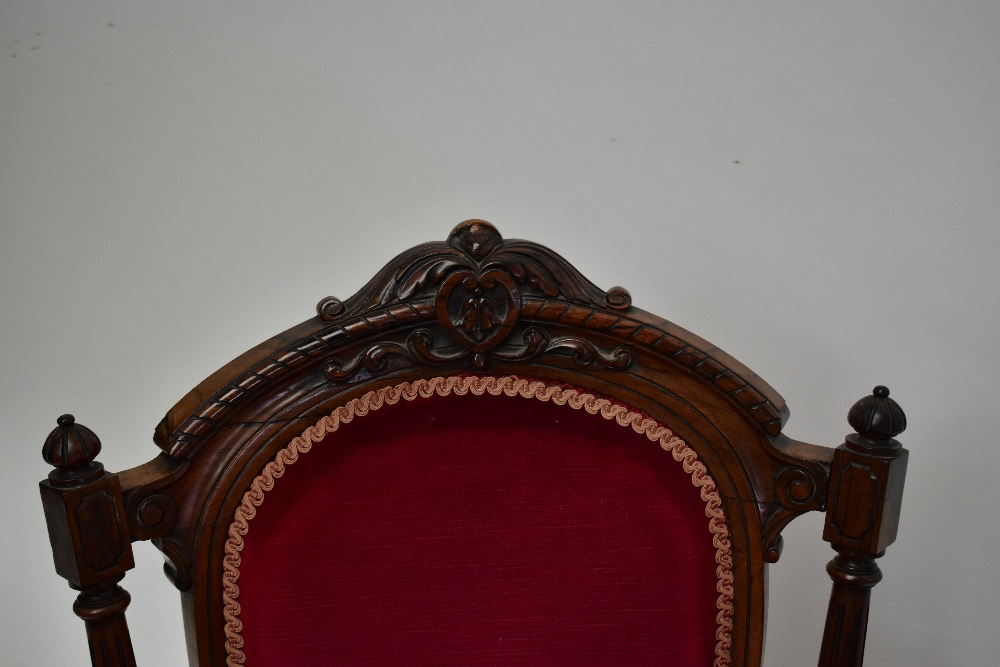 A Victorian carved rosewood lady's salon chair with burgundy dreylon upholstered back and seat on - Image 2 of 4