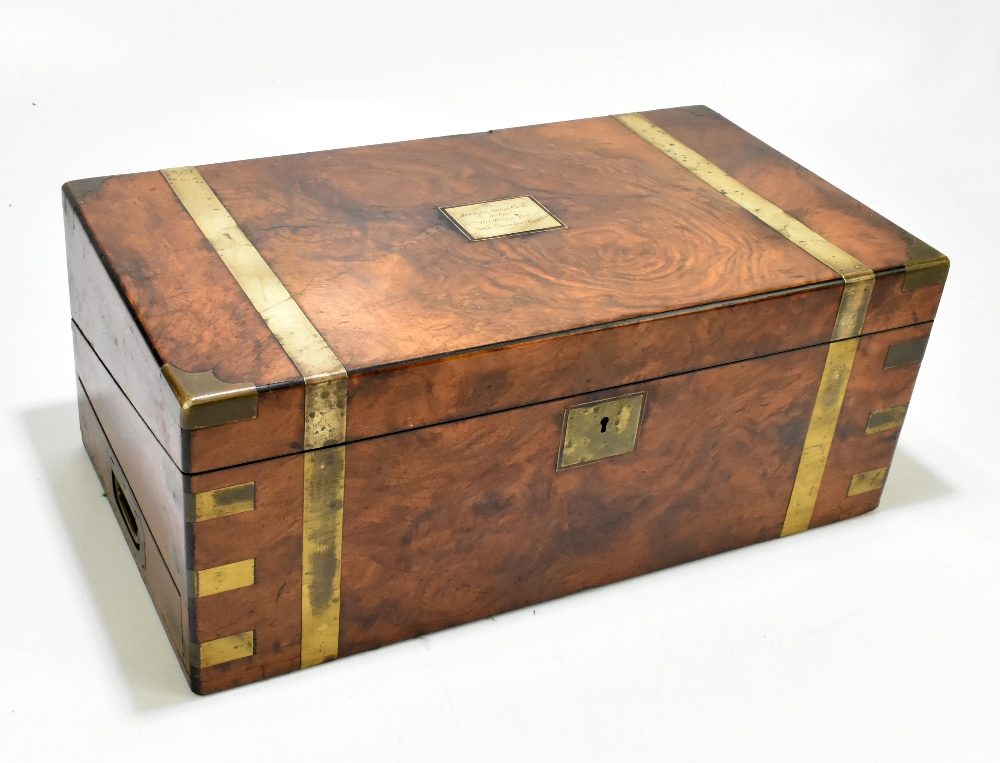 A 19th century walnut, burr walnut and brass bound writing slope, the cartouche to lid inscribed 'To