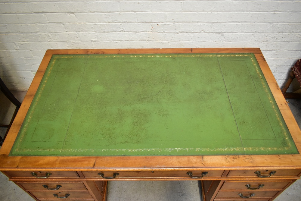 A reproduction yew wood pedestal desk, with green leather inset top above an arrangement of nine - Image 2 of 7