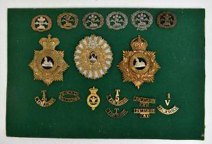 SOUTH LANCASHIRE REGIMENT; a good group of badges including a Second Battalion colour-belt badge