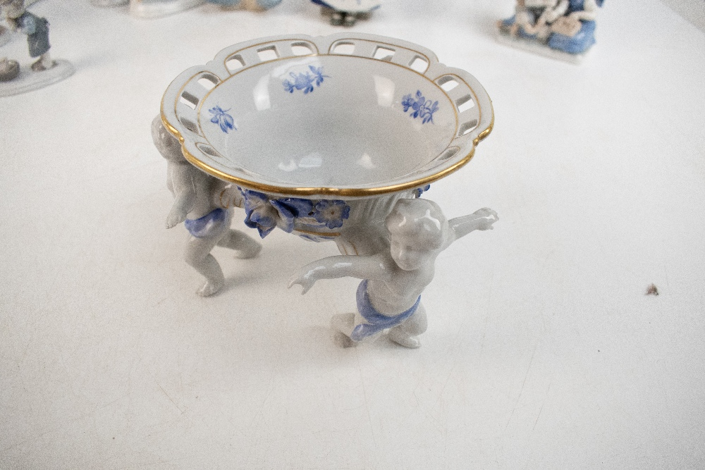 A group of ceramic figures with Lladro examples including drummer boy (af) and a Nao recling girl, - Image 2 of 4