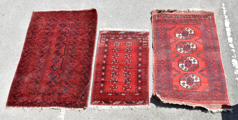 Three Eastern style rugs to include a Bokhara type example with four stylised symbols, 183 x