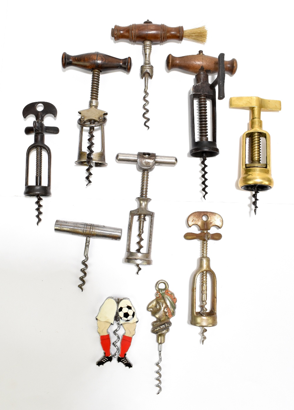 Ten corkscrews including Mister Punch, brass and three wooden handled examples (10).Additional