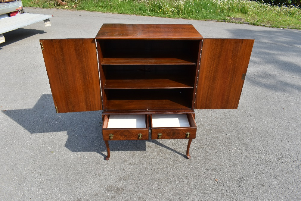 A Queen Anne style figured walnut cocktail cabinet with two doors enclosing two shelves above two - Image 2 of 5