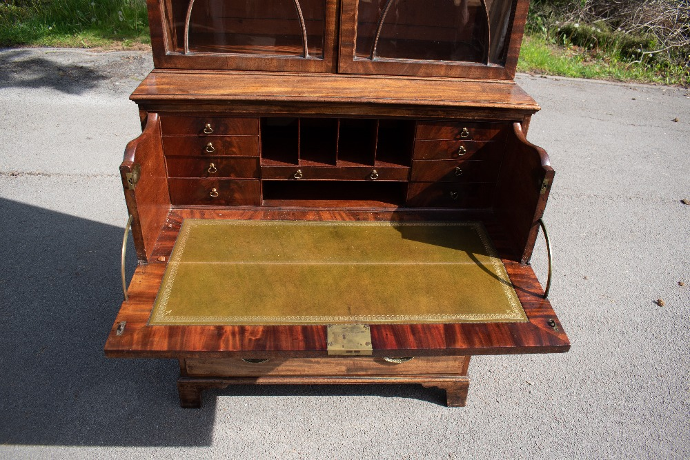 An early 19th century mahogany secretaire bookcase with moulded cornice above two astragal glazed - Image 2 of 6