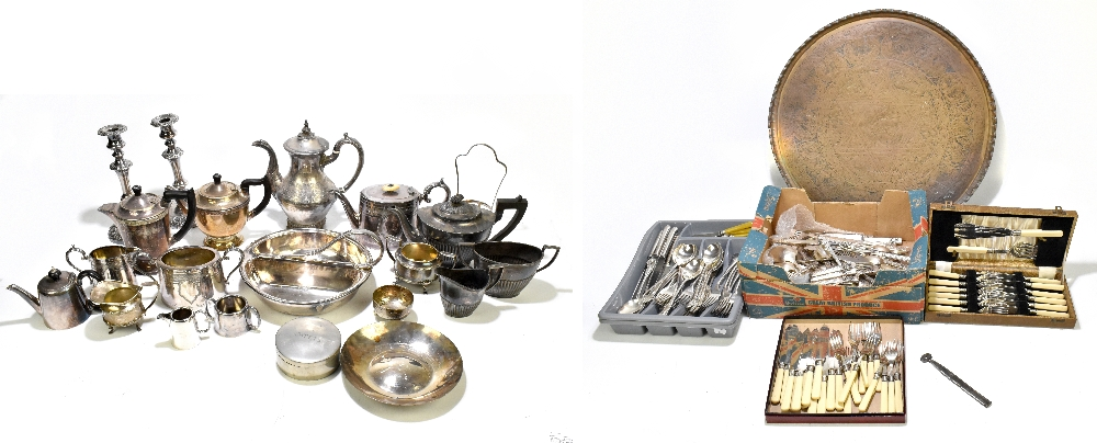 A collection of assorted silver plate to include part tea services, a pair of candlesticks, height