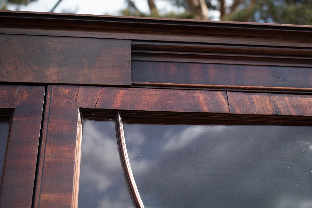 An early 19th century mahogany secretaire bookcase with moulded cornice above two astragal glazed - Image 3 of 6