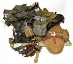 A group of military equipment including gas mask in small backpack, a set including water