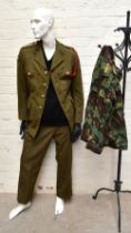 A No.2 dress military tunic with buttons and Tank Corps badges and trousers displayed on a mannequin