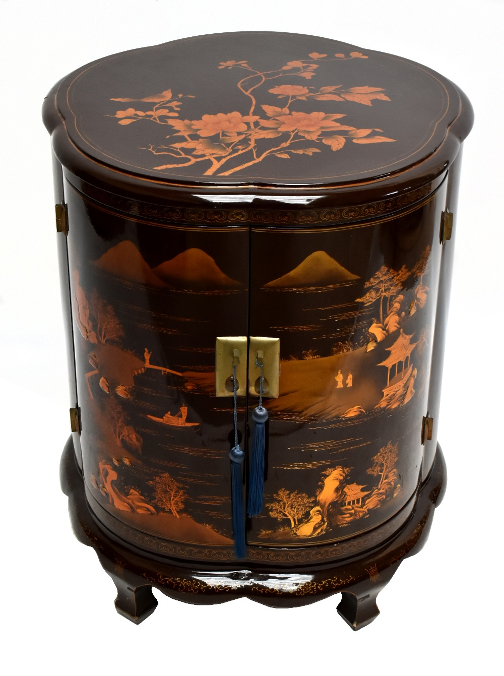 A modern Chinese lacquered drinks cabinet of shaped circular form, with chinoiserie decoration,