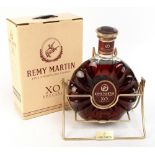 COGNAC; a Remy Martin XO Special three litre bottle, on gilt Remy Martin swivel stand complete