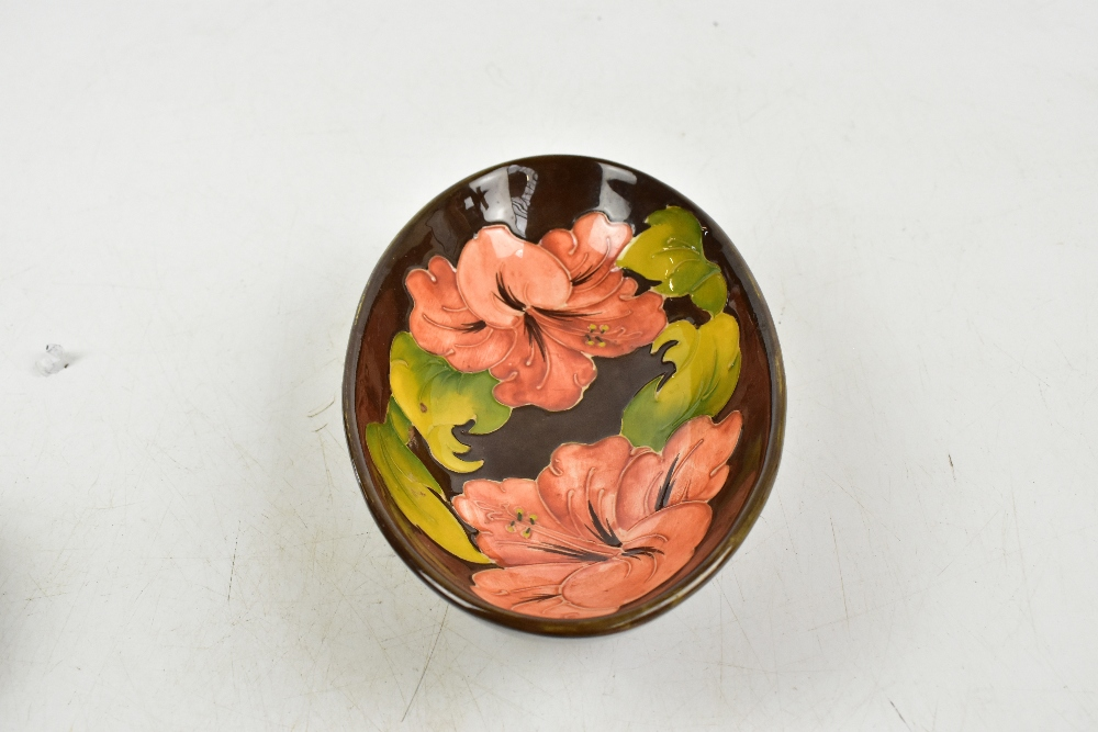 MOORCROFT; three pieces decorated in the Hibiscus pattern to include a squat vase, height 10cm ( - Image 3 of 9