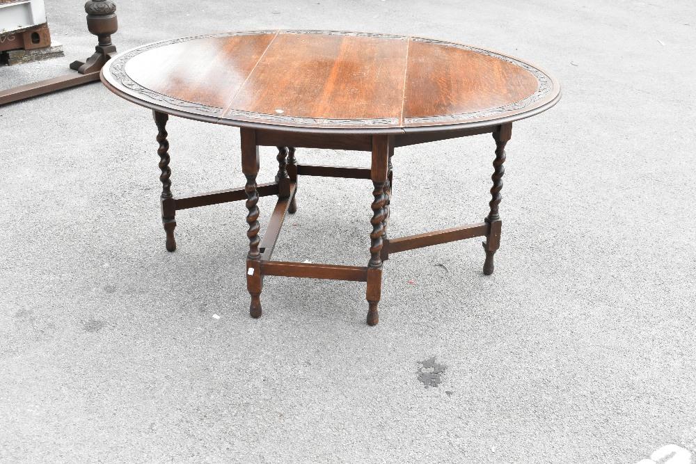 A 1920s carved oak gateleg table on barleytwist legs,height 72cm,width 107cm, with a similar set - Image 4 of 5