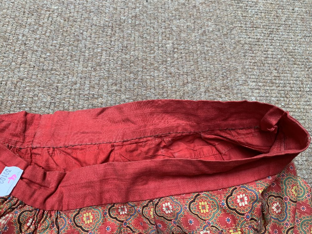 Two late Victorian quilted underskirts/winter petticoats, one decorated with a floral design against - Image 8 of 10