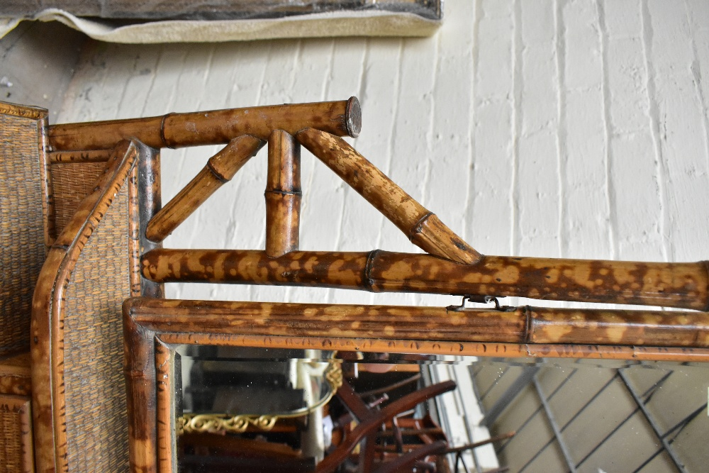 An early 20th century bamboo mirror back dressing table, with two drawers raised on column supports, - Image 4 of 7