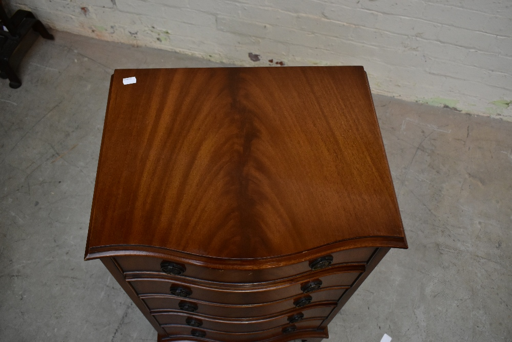 JAYCEE; a reproduction mahogany serpentine chest with moulded top above five graduated drawers, on - Image 3 of 5
