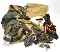 A group of military and military-type equipment including canvas bags, holsters, entrenching tool,