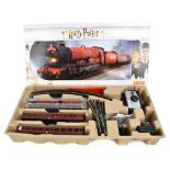 HORNBY; a boxed R1234 Harry Potter Hogwarts Express OO gauge electric train set.Additional